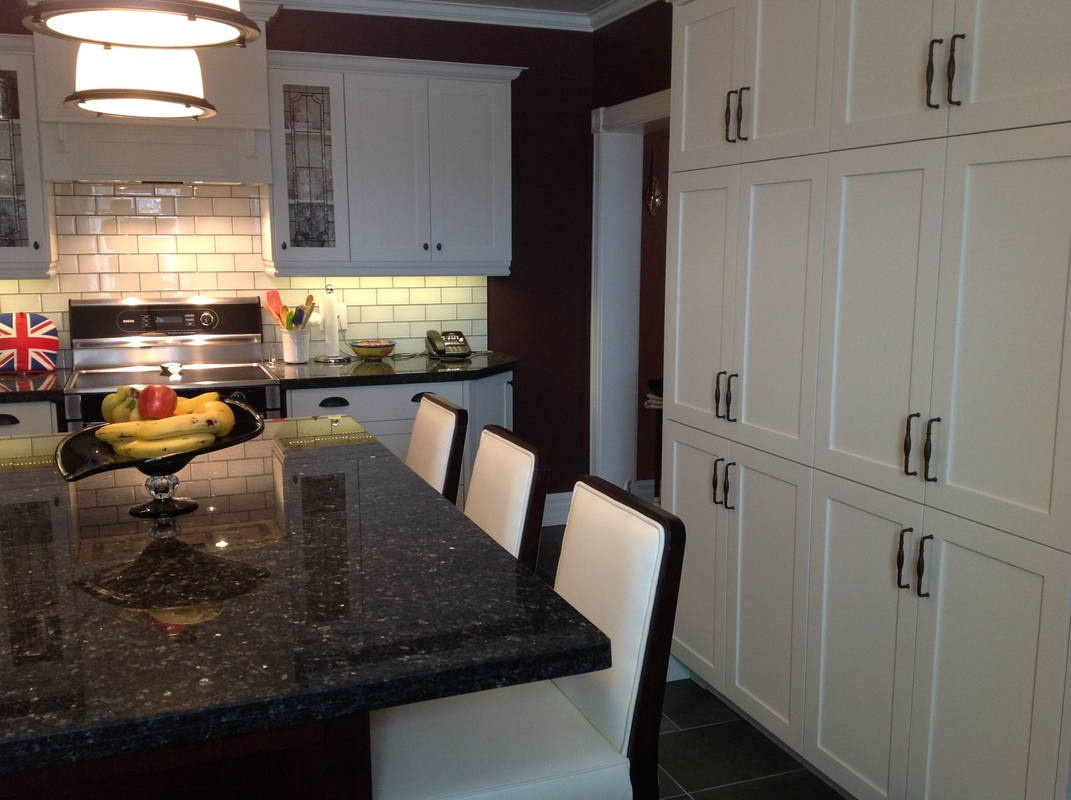 Picture large pantry in custom kitchen, pearl blue granite countertop, white subway tile, stained glass door