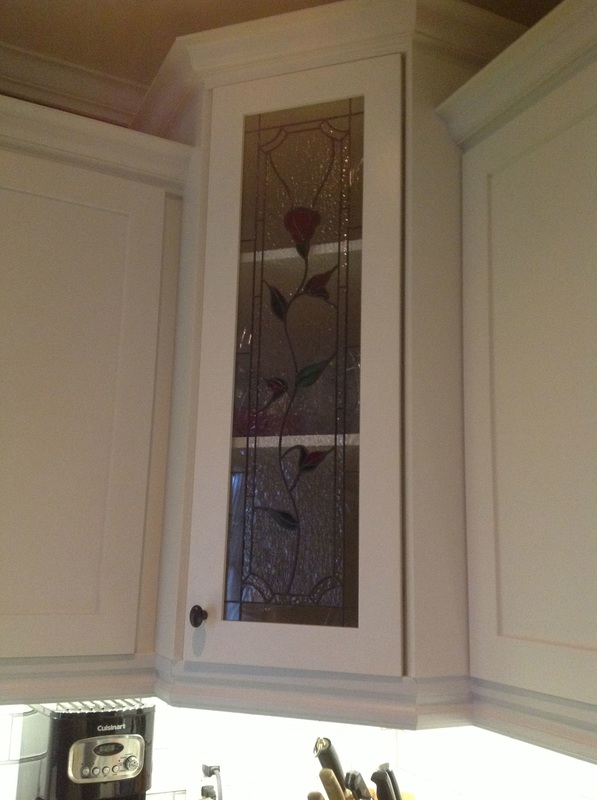 Picture custom stained glass door, crown molding, custom kitchen