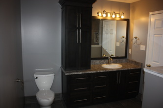 Custom vanity with granite top.