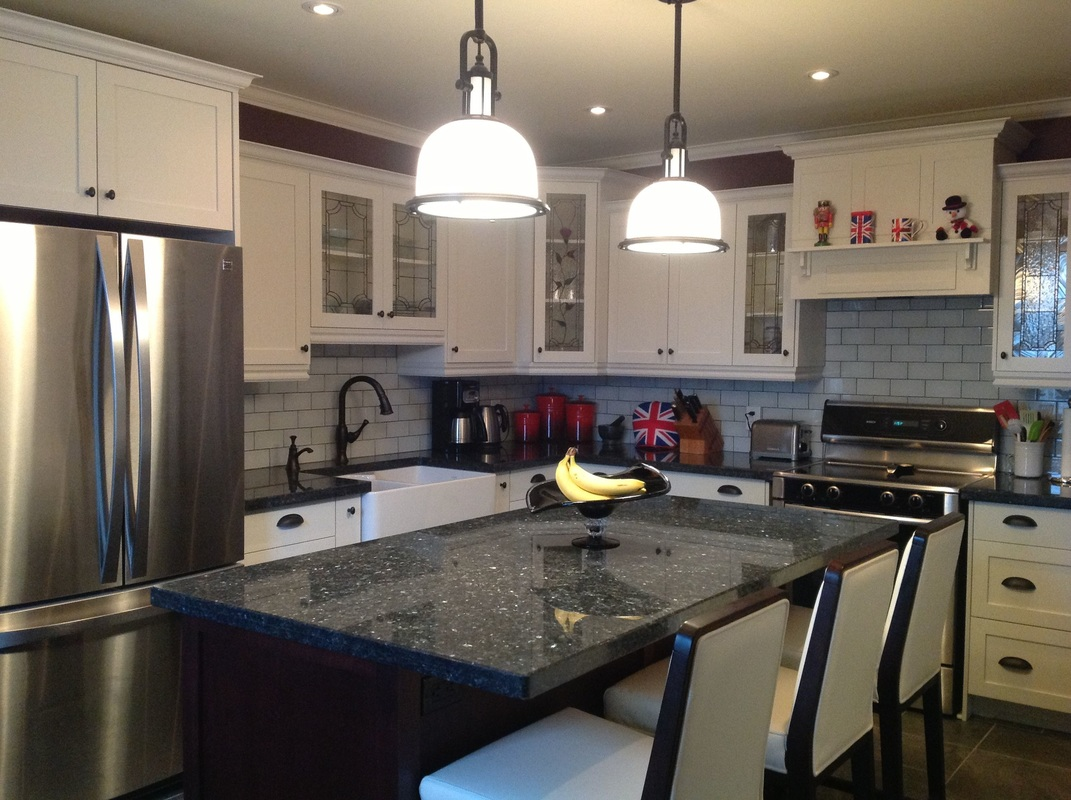 Picture Custom Kitchen, white shaker door, stained glass doors, custom hood vent, satinless steel appliances, pendant lights, peal blue granite counter top, frankie farm sink, white leather counter hight chairs - stools