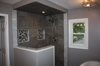 Custom tiles shower with his and her niches.