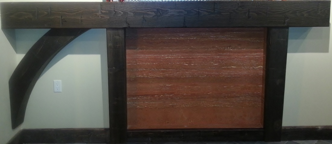 Picture Hollow timber mantel with arch, hollow timber corbels. Timber baseboards. Red travertine stone.