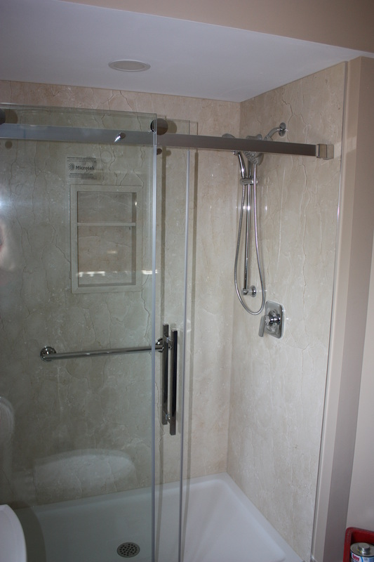 Picture stone panel shower, glass sliding door, Crema Marfil Marble panels