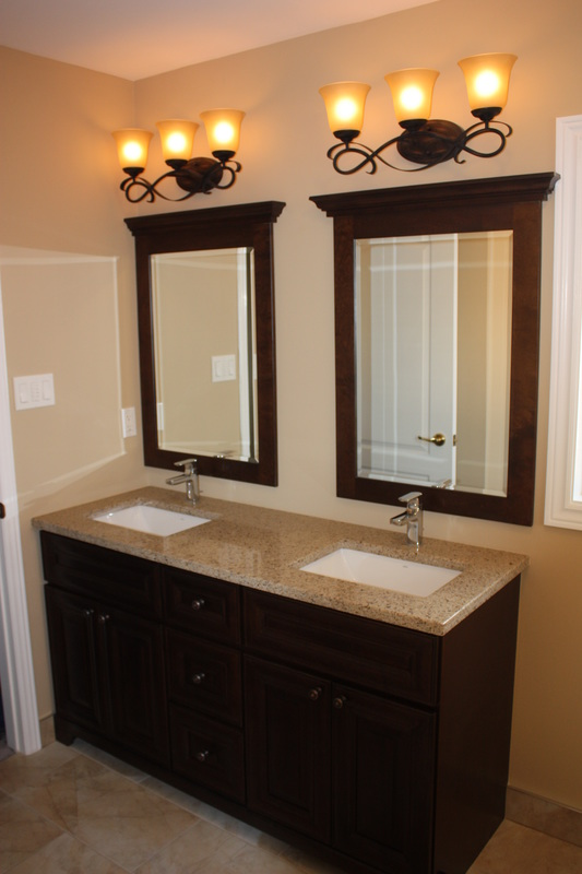 Picture double furnitre style vanity from Rock Soild. Matching mirrors, Moen chrome faucets